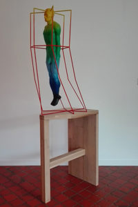 A person locked into a cage of his own mind visualized in a sculpture.