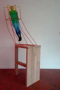 Sculpture of a person in a cage.
