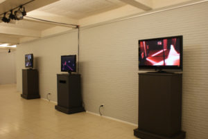3 flatscreen with safety camera's from inside an exhibition room.