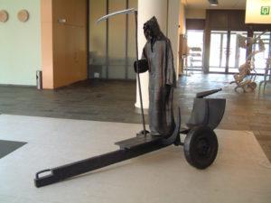 Grim Reaper large metal sculpture at an exhibition at Cultural Center De Adelberg Lommel Belgium.