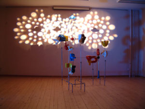 Exhibition view at CC. De Breughel Bree with an installation with polyester forms and special light by Niko Hendrickx.
