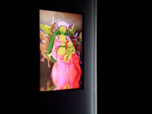 Flatscreen on the wall with a 3D interpretation of Jean Fouquet's painting Madonna Surrounded by Seraphs and Cherubs.