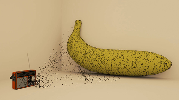 A radio is spreading paricles on to a banana.