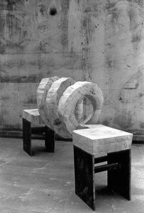 Wooden spirel formed into a bench with two sides.