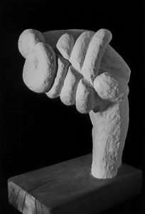 Plaster sculpture of an abstract hand.