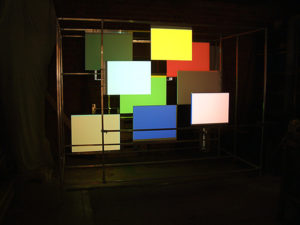 Projection onto an art installation with nine colors.