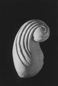Abstract plaster sculpture of a woman inspired by Brancusi.