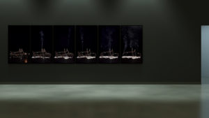 Exhibition view with six flatscreens with submarine going of in smoke.