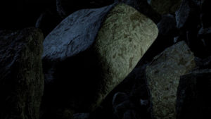 Colliding blocks of rock in dark space with a bit of sunlight.