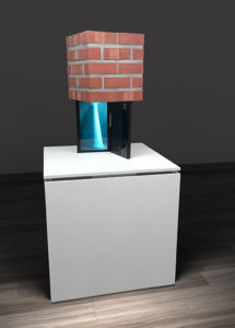 Block made of bricks resting on a laptop with a 3D animation of a twisting column.