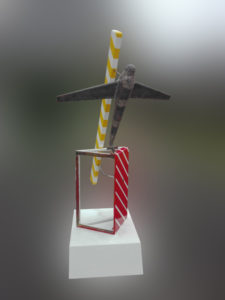 A sculpture with an up side down airplane with striped elements.
