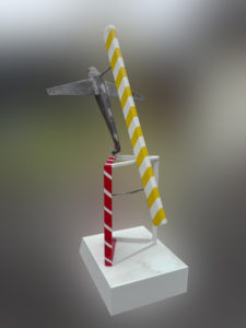 Sculpture with striped bar and a airplane.