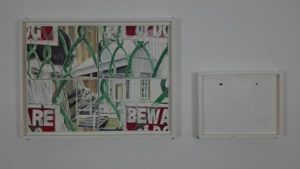 Changeable paintings with green wire and a house.