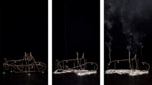 A submarine of incense goes of in smook.